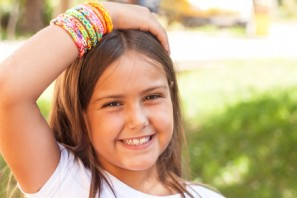 cute little girl with multicolored bracelets